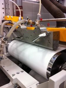 Il sistema a ugelli a lamina e la racla per l'inchiostrazione